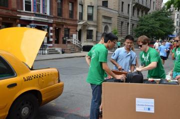 Orientation leaders help families unload and get settled.